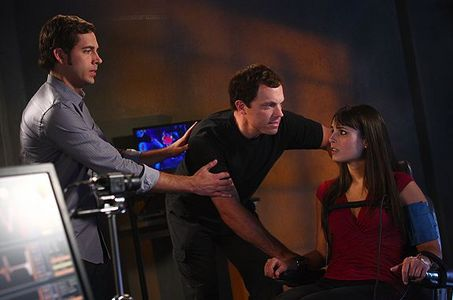 Casey interrogates Jill as Chuck looks on.